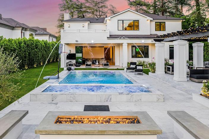 """<p>Boston Celtics player Tristan Thompson's Encino, California, home is on the market, but certainly not for long. Situated on 18,843 square feet of land, the NBA star's former manse opens into a grand foyer boasting Parisian-inspired checkered marble floor that stops just short of the dining and living rooms, which flank the entryway's main staircase.</p> <p>Though the house is ultra-cool in its own right, perhaps the property's most obvious selling point is its backyard, which features an outdoor kitchen, bar, pool, spa, and fire pit surrounded by built-in seating. Plus, there's a spacious 1,580-square-foot two-bedroom guest house with a family room and a fully functioning kitchenette. Timer Fridman, founder of The Fridman Group, urges buying in this area—especially right now. He says, """"The real estate market in L.A. is extremely active. It has become a destination for numerous domestic buyers, particularly following 2020.""""</p> <p>Price: $7.9 million</p> <p>Beds/Baths: 7 bedrooms, 7 full bathrooms, 1 half bathroom</p> <p>Square Footage: 9,864 square feet</p> <p>For more information, please click <a href=""""https://www.thefridmangroup.com/property/4421-haskell-avenue-encino-california-91436-united-states-of-america"""" rel=""""nofollow noopener"""" target=""""_blank"""" data-ylk=""""slk:here"""" class=""""link rapid-noclick-resp"""">here</a>.</p>"""