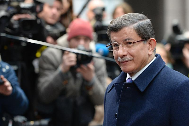 Turkish Prime Minister Ahmet Davutoglu arrives for a European Union summit in Brussels, on March 18, 2016