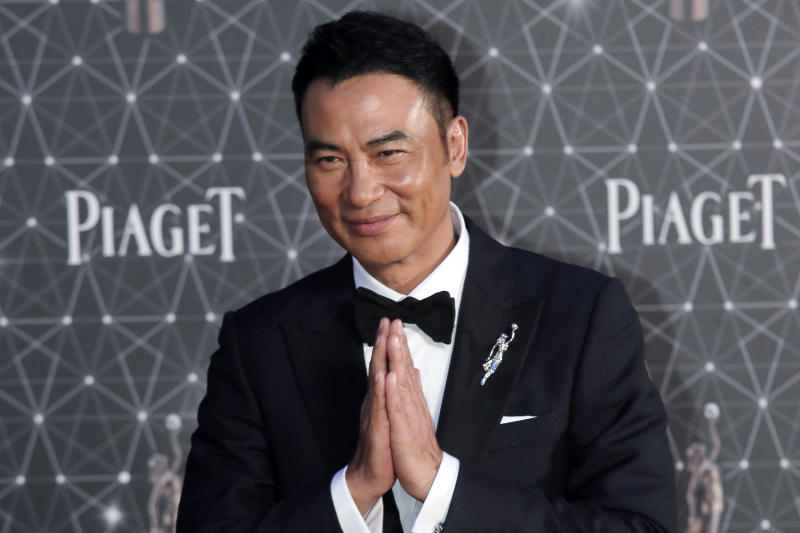 FILE - In this file photo taken Sunday, April 3, 2016, Hong Kong actor Simon Yam poses on the red carpet of the Hong Kong Film Awards in Hong Kong. Yam was stabbed Saturday, July 20, 2019 while attending an event in southern China. (AP Photo/Vincent Yu, File)