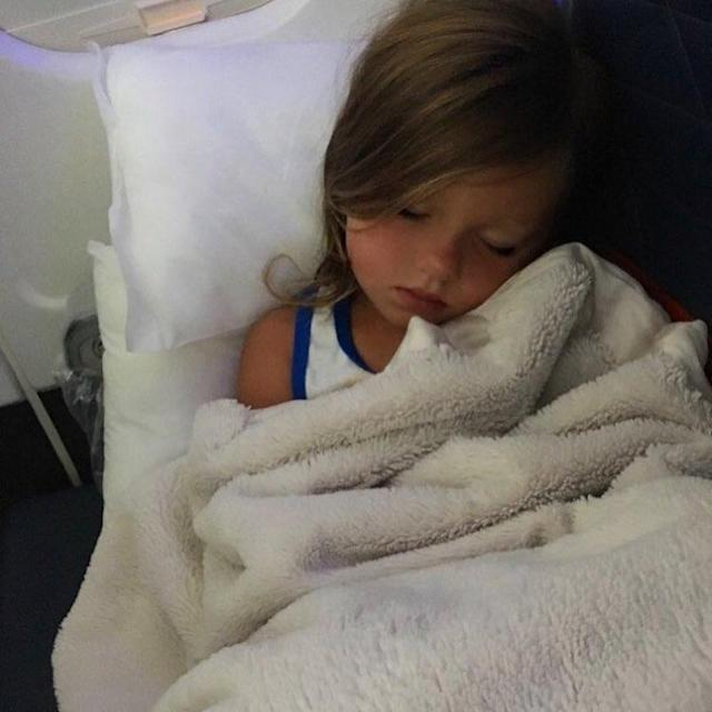 """<p>On their way home, little Kaia passed out on the plane. """"My view right now,"""" wrote Kim. (Photo: <a href=""""https://www.instagram.com/p/BVF4O4jBloR/"""" rel=""""nofollow noopener"""" target=""""_blank"""" data-ylk=""""slk:Kim Zolciak-Biermann via Instagram"""" class=""""link rapid-noclick-resp"""">Kim Zolciak-Biermann via Instagram</a>) </p>"""