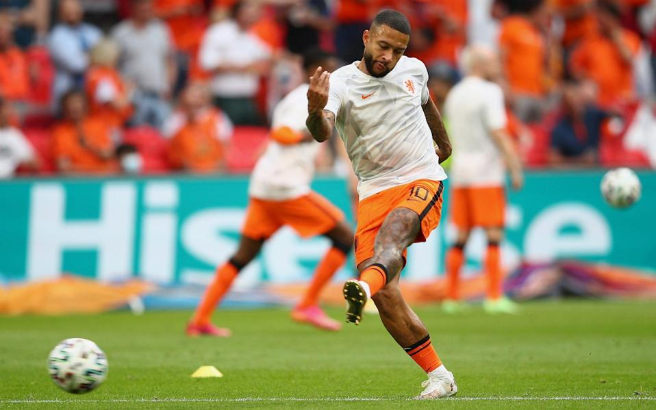 Memphis Depay practises his finishing in the warm-up - GETTY IMAGES