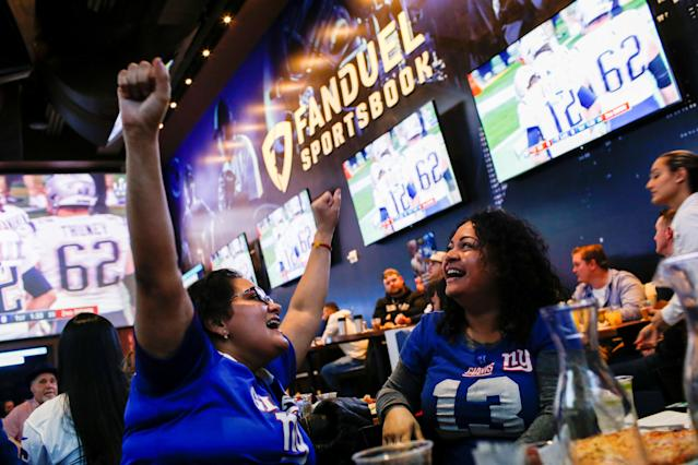 Silquia Patel, (R), 29, celebrates after making her bets at the FANDUEL sportsbook during the Super Bowl LIII in East Rutherford, New Jersey, U.S., February 3, 2019. REUTERS/Eduardo Munoz