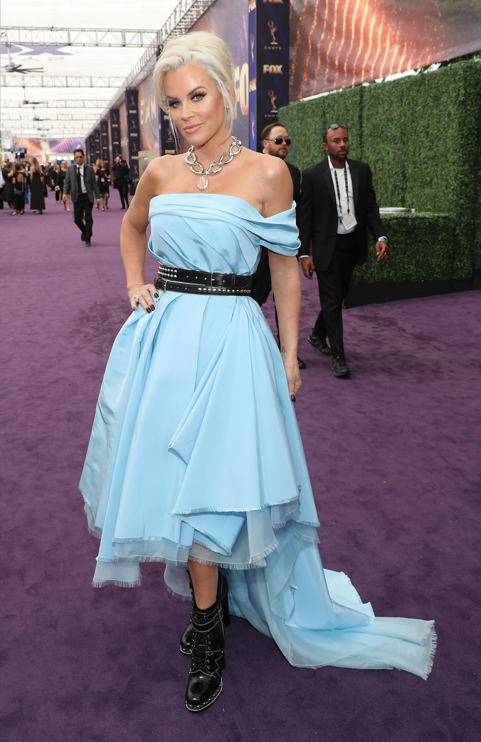 <p>In 2019, Jenny McCarthy added a punk-princess twist to her off the shoulder blue gown that looked more like a D.I.Y. project gone wrong rather than an Emmy worthy look (Image via Getty Images).</p>