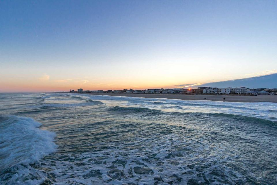 A view of the sunset from the water at Wrightsville Beach