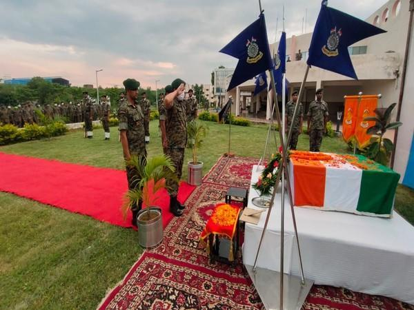 CRPF personnel paying tribute to sniffer dog 'Drone'  in Jharkhand's Gumla. (Photo/ ANI)