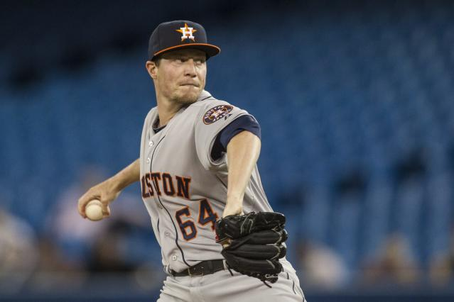 Houston Astros starting pitcher Lucas Harrell works against Toronto Blue Jays during the first inning of a baseball game Wednesday, April 9, 2014, in Toronto. (AP Photo/The Canadian Press, Chris Young)