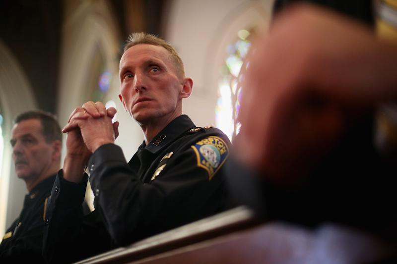 BOSTON, MA - APRIL 21:  Boston Police Department Superintendent William Evans (C) and Kevin Buckley (L) attend mass at the Cathedral of the Holy Cross on the first Sunday after the Boston Marathon bombings on April 21, 2013 in Boston, Massachusetts.  The Mass honored the victims of the bombings and subsequent manhunt as well as first responders. (Photo by Mario Tama/Getty Images)