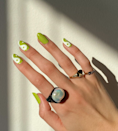 """Make a yin yang even cooler with a poppy green shade. <a href=""""https://shop-links.co/1700938470390081200"""" rel=""""nofollow noopener"""" target=""""_blank"""" data-ylk=""""slk:We love this one from Sally Hansen"""" class=""""link rapid-noclick-resp"""">We love this one from Sally Hansen</a>."""