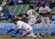Chicago Cubs starter Scott Feldman, bottom, can't make the catch from first baseman Anthony Rizzo as San Francisco Giants' Angel Pagan(16) is safe at first base during the first inning of a baseball game in Chicago, Thursday, April 11, 2013. (AP Photo/Nam Y. Huh)