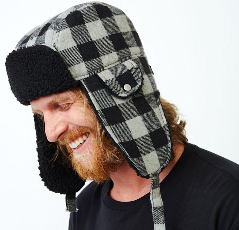 """You may want to hibernate all winter, but your kids don't. Lean in to sledding, skating, and snowman-making with a hat to keep you warm. Get it at <a href=""""https://www.roots.com/ca/en/roots-park-plaid-trapper-hat-43010136.html?cgid=NewForPlaidsMens&amp;start=11&amp;selectedColor=004&amp;itemsourse=productlist"""" target=""""_blank"""" rel=""""noopener noreferrer"""">Roots</a>, $48."""