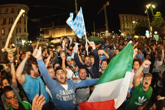 Napoli's fans celebrate their team's victory against Juventus in Naples on May 21, 2012. S.S.C. Juventus' record-breaking 43-match undefeated run came to an end when Napoli won the Italian Cup 2-0. AFP PHOTO/ ANDREA BALDOANDREA BALDO/AFP/GettyImages