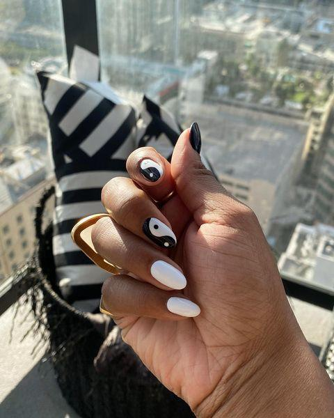 """<p>While the ring finger has long reigned as an accent nail (at a push, the pinky) - change is afoot. We're heralding the start of a new nail mood: one that takes the index and middle finger and promotes them to the status of accent nails.<br><br>To pull this look off, choose a pattern consisting of two colours (or black and white), and complement the accent nails using those same colours in clock form across your thumb, pinky and ring finger. The result is a gorgeously cohesive look which refreshes the whole accent nail vibe by employing tonal methods.<br></p><p><a href=""""https://www.instagram.com/p/B99dpmzA8Wk/"""" rel=""""nofollow noopener"""" target=""""_blank"""" data-ylk=""""slk:See the original post on Instagram"""" class=""""link rapid-noclick-resp"""">See the original post on Instagram</a></p>"""