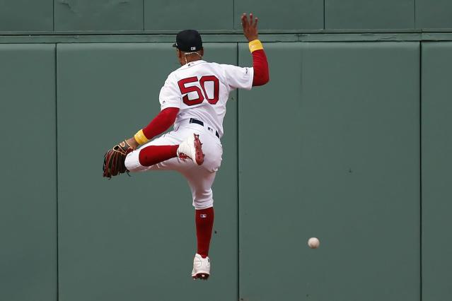 Boston Red Sox's Mookie Betts can not make the catch on a double hit by New York Yankees' Luke Voit during the eighth inning of a baseball game in Boston, Saturday, Sept. 7, 2019. (AP Photo/Michael Dwyer)