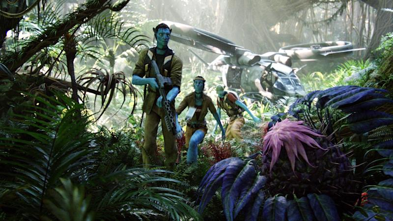 Jake and other humans in Na'vi avatars, exploring Pandora. (Credit: 20th Century Fox)