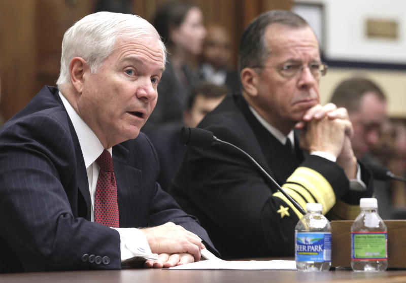 Defense Secretary Robert Gates, left, accompanied by Joint Chiefs Chairman Adm. Michael Mullen, testifies on Capitol Hill in Washington, Thursday, March 31, 2011, before the House Armed Services Committee hearing on military operations in Libya. (AP Photo/Carolyn Kaster)