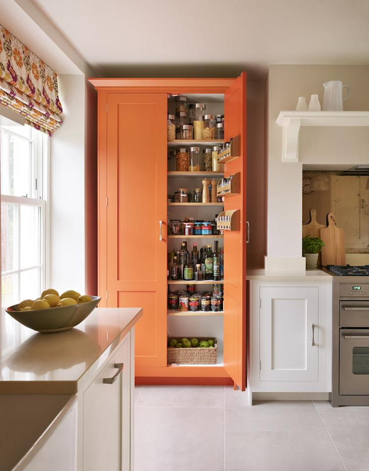 "<p>Beautiful to look at and practical to use, elevate your kitchen space with this colourful larder. Opt for zesty orange to brighten a neutral space.<br></p><p>• See more from <a href=""https://www.harveyjones.com/"" target=""_blank"">Harvey Jones</a></p><p><strong>READ MORE:</strong> <a href=""https://www.housebeautiful.com/uk/decorate/kitchen/a23569477/kitchen-colour-ideas/"" target=""_blank"">7 bold and beautiful kitchen colour ideas</a></p>"