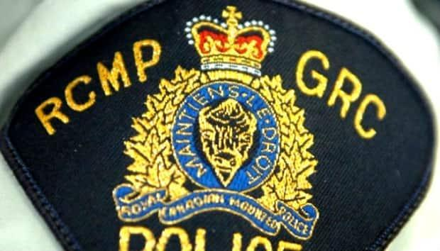 The woman was a passenger in a car that RCMP believe collided with a transport truck when attempting to change lanes.