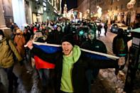 People in downtown Moscow protest against a prison term handed down against opposition leader Alexei Navalny