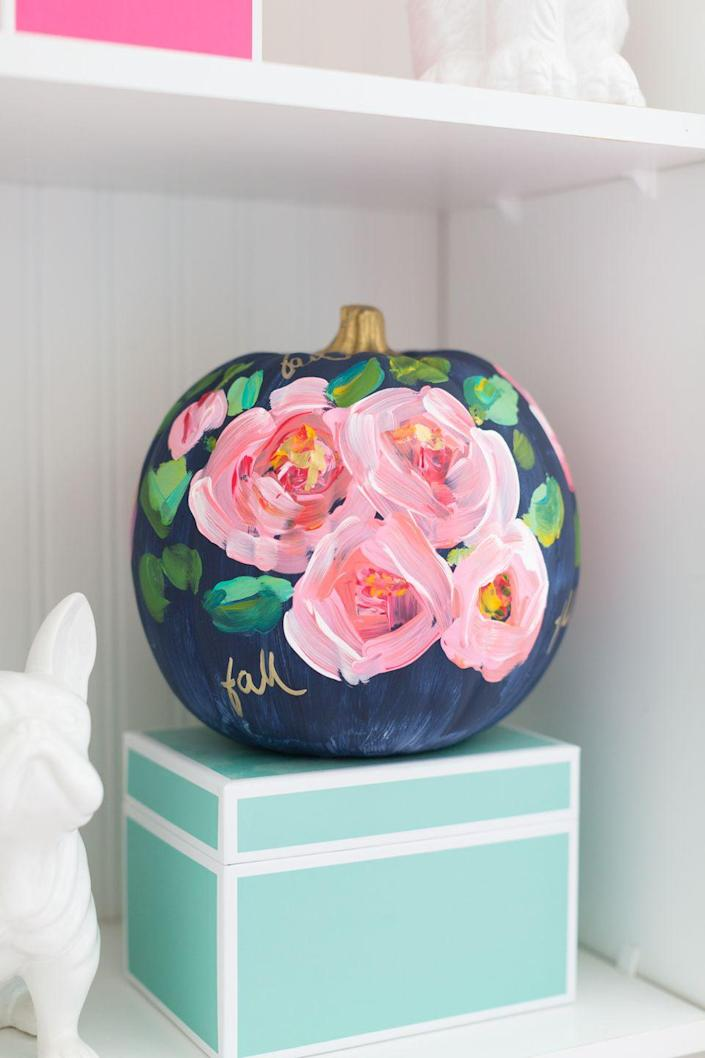"""<p>Skip the traditional colors of Halloween and embrace a floral motif (complete with a gold stem!) instead.</p><p><strong><em>Get the tutorial from <a href=""""http://www.craftberrybush.com/2016/09/hand-painted-floral-pumpkin.html"""" rel=""""nofollow noopener"""" target=""""_blank"""" data-ylk=""""slk:Craftberry Bush"""" class=""""link rapid-noclick-resp"""">Craftberry Bush</a>.</em></strong> </p>"""