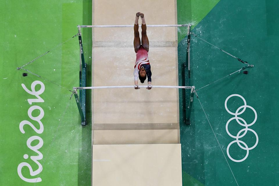 <p>Gabrielle Douglas of the United States competes on the uneven bars during the Artistic Gymnastics Women's Team Final on Day 4 of the Rio 2016 Olympic Games at the Rio Olympic Arena on August 9, 2016 in Rio de Janeiro, Brazil. (Photo by Ian Walton/Getty Images) </p>