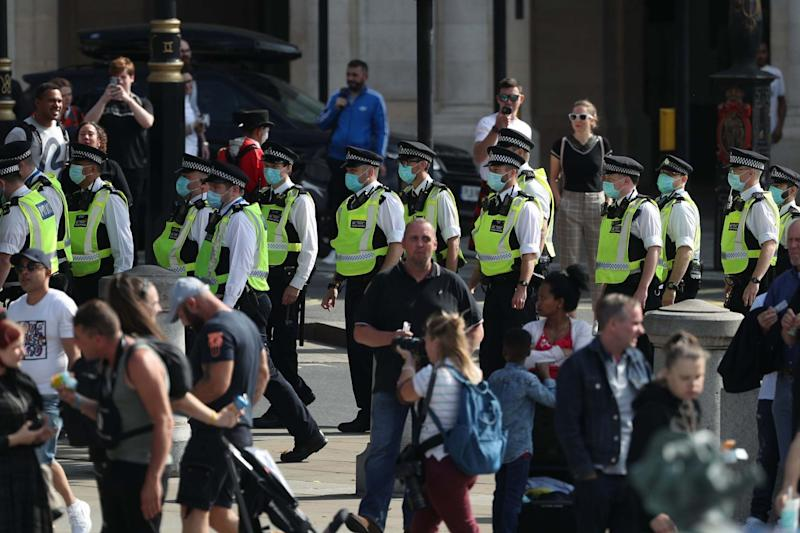 Police presence at an anti-vax protest in London's Trafalgar Square (PA)