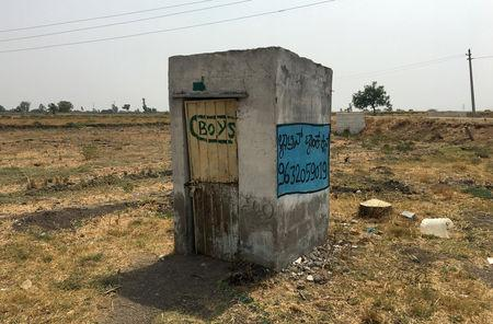 A toilet is pictured in a field outside a school near Jaikisan Camp village in the southern state of Karnataka, India, India, April 30, 2019.  REUTERS/Sachin Ravikumar