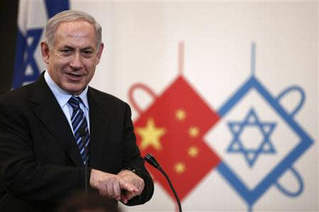 Israel's Prime Minister Benjamin Netanyahu gives a speech during a gala dinner in Shanghai in this May 6, 2013 file photo. REUTERS/Aly Song/Files