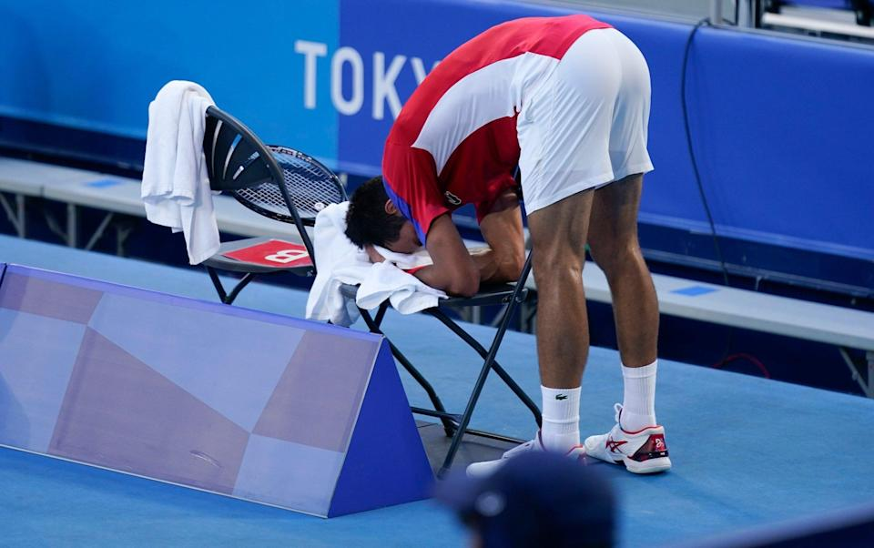 Novak Djokovic, of Serbia, reacts during the bronze medal match of the tennis competition against Pablo Carreno Busta, of Spain, at the 2020 Summer Olympics, Saturday, July 31, 2021, in Tokyo, Japan - AP
