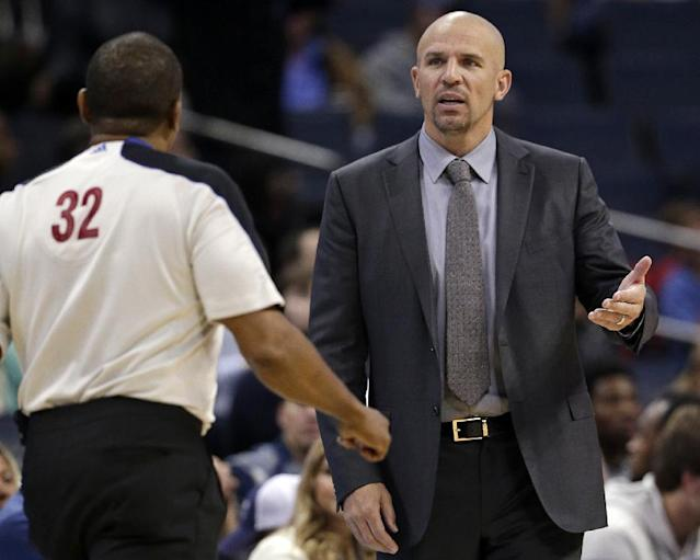 Brooklyn Nets head coach Jason Kidd, right, argues a call with referee Eddie F. Rush, left, during the second half of an NBA basketball game in Charlotte, N.C., Wednesday, Nov. 20, 2013. The Bobcats won 95-91. (AP Photo/Chuck Burton)