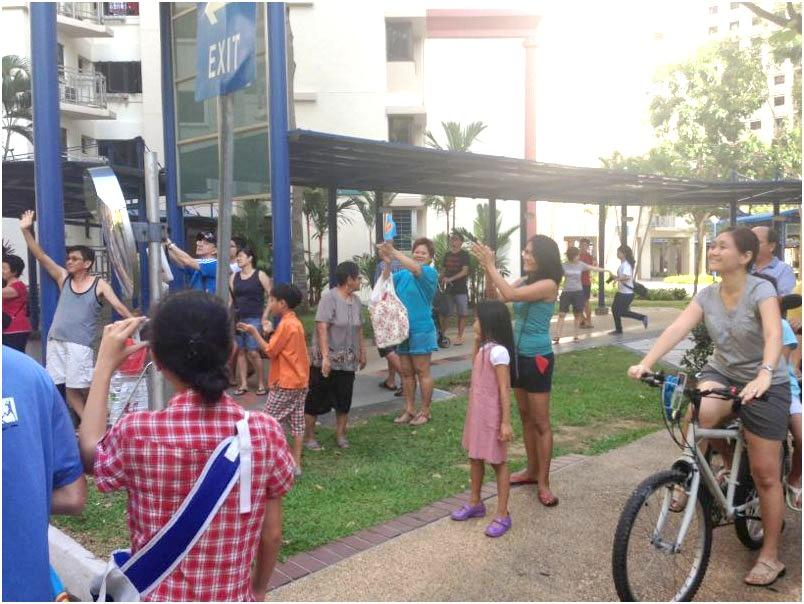 Punggol East residents claps and cars toot their horns as Workers' Party's parade convoy passes by.