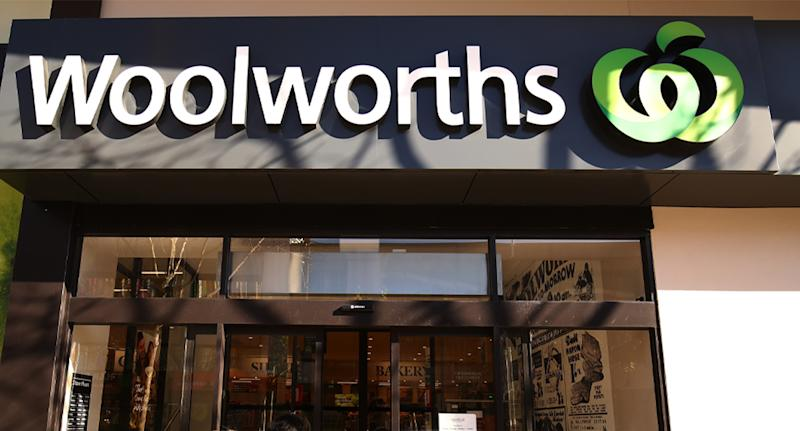 Photo shows the front of a Woolworths store.
