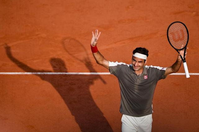 Roger Federer is into his eighth French Open semi-final (AFP Photo/Martin BUREAU)