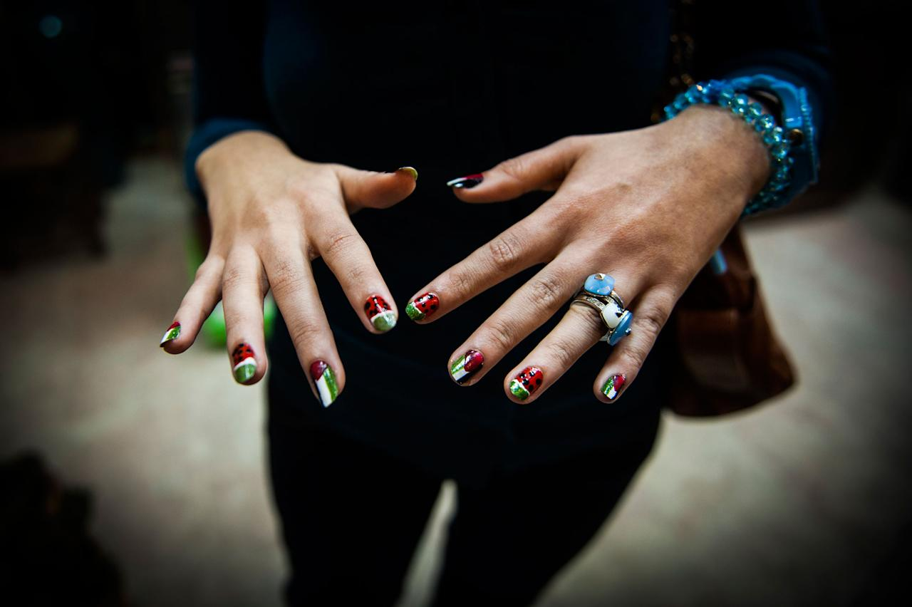 <p>A girl shows off her Palestinian themed nails after a recent bombing campaign. (Photograph by Monique Jaques) </p>
