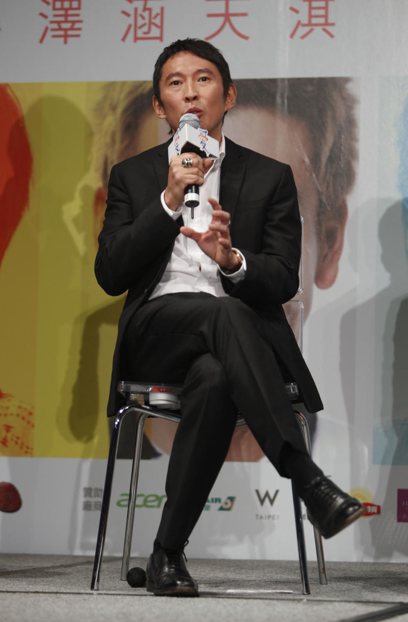 """Taiwanese director/actor Doze Niu answers questions during a media event in the lead up to the premiere of his new film entitled """"Love"""" in Taipei, Taiwan, Tuesday, Feb. 7, 2012. The romantic drama """"Love"""" opens on Valentine's Day, Feb. 14, 2012. (AP Photo/Wally Santana)"""