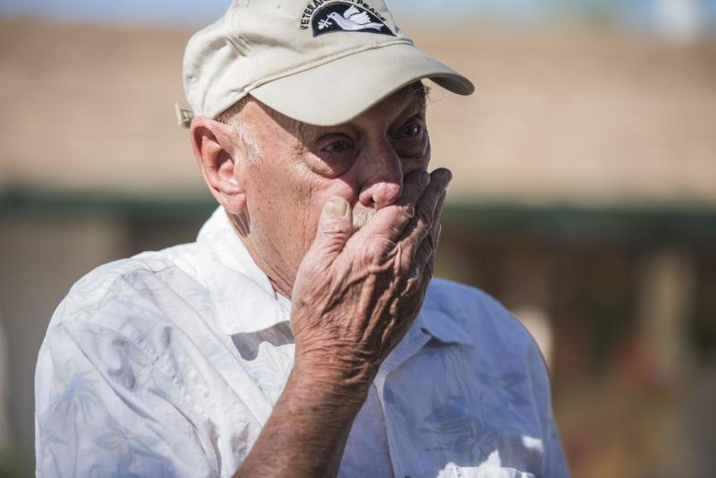 Dan Kelly, a 72-year-old Vietnam veteran, cries while explaining the humanitarian crisis on the border of the U.S. and Mexico. (Damon Dahlen/HuffPost)