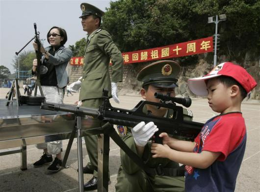 Visitors check out weapons at a People's Liberation Army (PLA) camp during its Open Day in Hong Kong May 1, 2007, two months before the former British colony celebrates the 10th anniversary of its handover to Chinese rule.