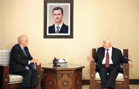 Syria's Foreign Minister Walid Moualem meets UNICEF)Director Anthony Lake in Damascus