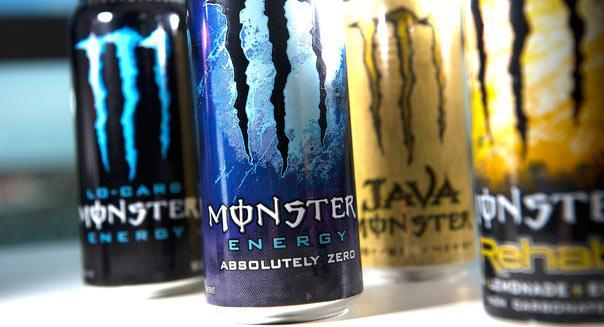 Cans of Monster Beverage Corp. energy drinks are displayed for a photograph in San Francisco, California, U.S., on Monday, April 30, 2012. Monster Beverage Corp. surged the most in almost eight years after the Wall Street Journal reported Coca-Cola Co. is in talks to buy the maker of energy drinks. Photographer: David Paul Morris/Bloomberg