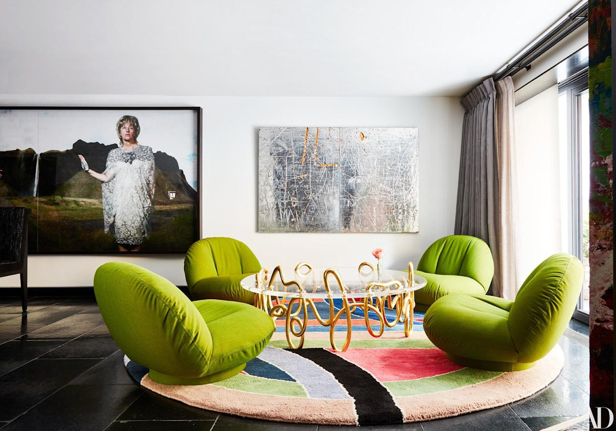 """<div class=""""caption""""> A vintage Frank Stella rug decorates a seating area. Photograph (left) by Cindy Sherman; artwork (right) by Rudolf Stingel. </div>"""