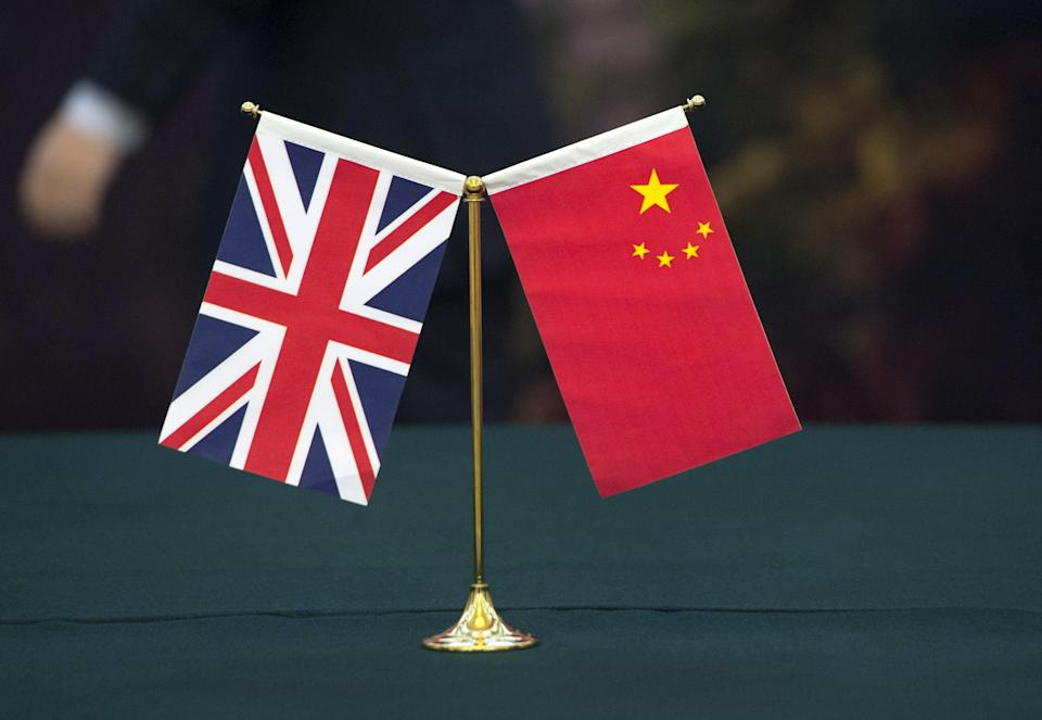 <p>UK and Chinese flags</p> (PA Wire)