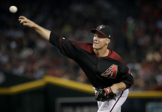 Arizona Diamondbacks starting pitcher Zack Greinke throws against the Milwaukee Brewers during the first inning of a baseball game, Saturday, July 20, 2019, in Phoenix. (AP Photo/Matt York)