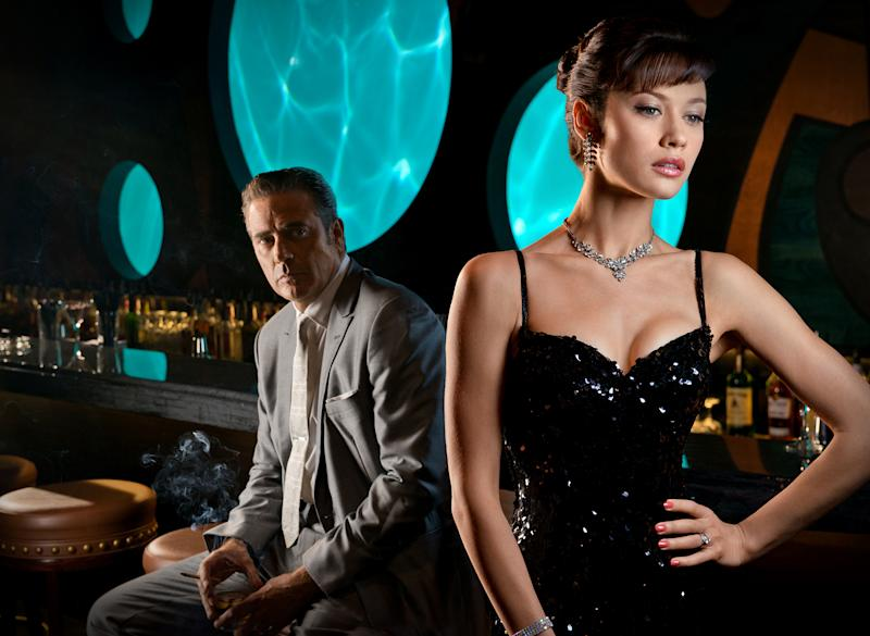 """This publicity image released by Starz, shows actor Jeffrey Dean Morgan, left, and actress Olga Kurylenko in a scene from the second season of the series """"Magic City,"""" set in Miami, Fla. The second season premieres Friday, June 14 at 9 p.m. on Starz. (AP Photo/Starz, Justina Mintz)"""