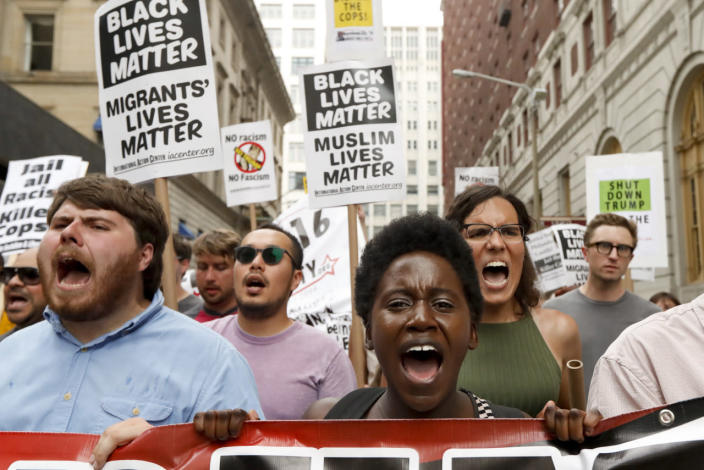 <p>Demonstrators take part in the Shut Down Trump and the RNC protest on July 17, 2016, in Cleveland, Ohio. (Photo: John Minchillo/AP)</p>