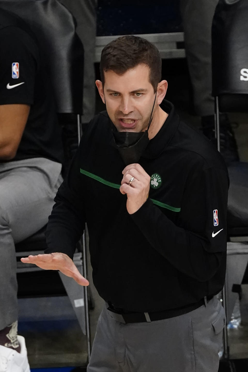 Boston Celtics head coach Brad Stevens talks to his players on the court in the second half of an NBA basketball game against the Atlanta Hawks Wednesday, Feb. 24, 2021, in Atlanta. (AP Photo/John Bazemore)