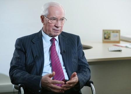 Former Ukrainian Prime Minister Mykola Azarov speaks during an interview with Reuters in Moscow