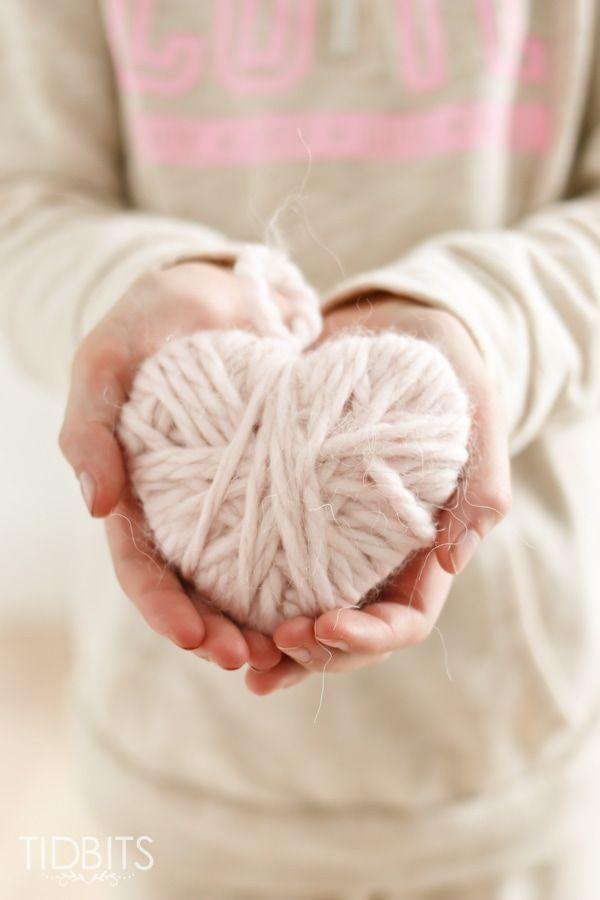 """<p>String these pretty-in-pink hearts together to make a garland that gives off a warm and cozy vibe. </p><p><em><a href=""""https://www.tidbits-cami.com/valentine-yarn-heart/"""" rel=""""nofollow noopener"""" target=""""_blank"""" data-ylk=""""slk:Get the tutorial at Tidbits »"""" class=""""link rapid-noclick-resp"""">Get the tutorial at Tidbits »</a></em></p>"""