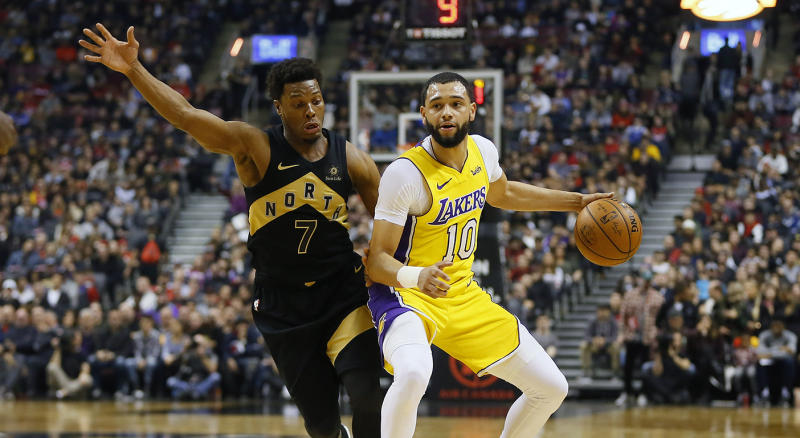 Jan 28, 2018; Toronto, Ontario, CAN; Los Angeles Lakers guard Tyler Ennis (10) tries to get around Toronto Raptors guard Kyle Lowry (7) during the first half at the Air Canada Centre. Mandatory Credit: John E. Sokolowski-USA TODAY Sports