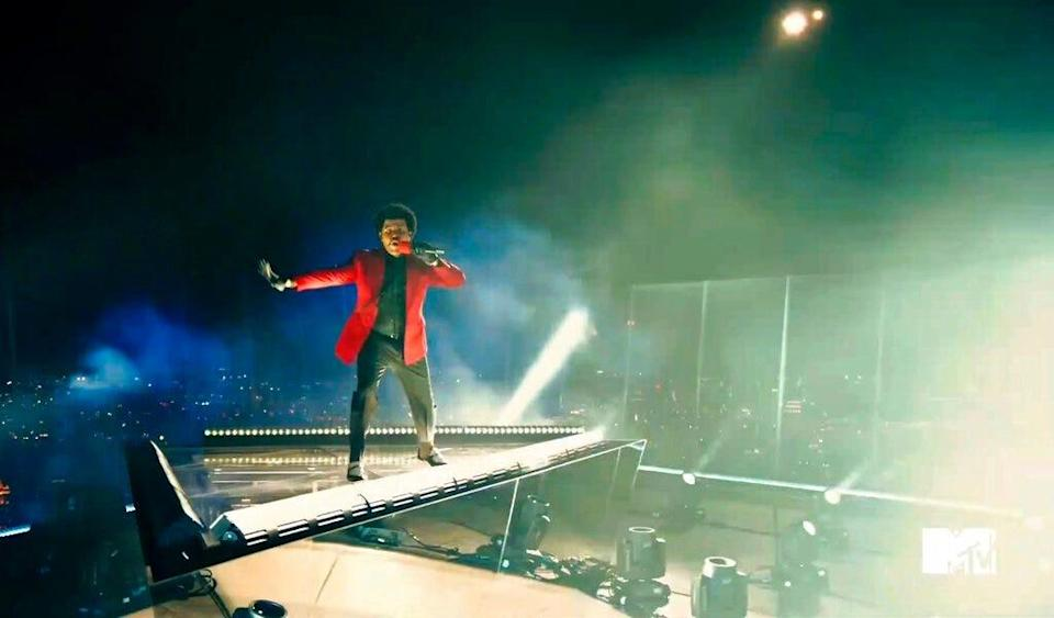 """In this video grab issued Sunday by MTV, The Weeknd performs """"Blinding Lights"""" during the MTV Video Music Awards."""