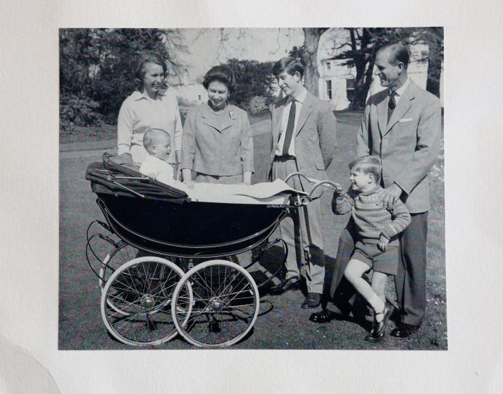 """<p>In 1965, the royal family welcomed <a href=""""https://www.townandcountrymag.com/society/tradition/a12808670/prince-edward-facts/"""" rel=""""nofollow noopener"""" target=""""_blank"""" data-ylk=""""slk:Prince Edward"""" class=""""link rapid-noclick-resp"""">Prince Edward</a> and card featured the larger group smiling around his carriage.</p>"""