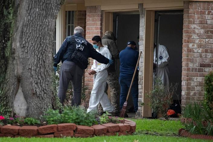 """<div class=""""inline-image__caption""""><p>Homeland Security Investigations personnel escort a man from the home on Friday.</p></div> <div class=""""inline-image__credit"""">Reuters</div>"""